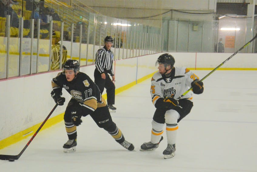 Sean Larochelle of the Cape Breton Eagles, right, slams on the brakes to protect the puck while being closely defended by the Charlottetown Islanders' Ryan Maynard. The Eagles defeated the Islanders 4-2 in a Quebec Major Junior Hockey League preseason game at MacLauchlan Arena in Charlottetown on Saturday.