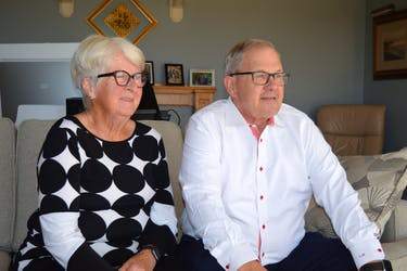 Cardigan MP Lawrence MacAulay, right, and his wife, Frances, watch the national news in their living room in St. Peters Bay on Sept. 20 ahead of the federal election results that night.