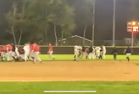 Members of the Sydney Sooners and Dartmouth Mooseheads are shown during a bench-clearing brawl near second base in Game 1 of the Nova Scotia Senior Baseball League championship series at Beazley Field in Dartmouth on Saturday. In total, four players were suspended in the incident.