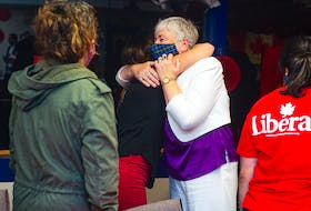 Former fisheries minister Bernadette Jordan hugs supporters at the Bridgewater Curling Club after losing to PC candidate Rick Perkins in the federal election on Monday, Sept. 20, 2021.
