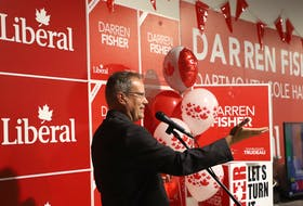 Liberal incumbent Darren Fisher speaks and celebrates with his supporters after taking Dartmouth-Cole Harbour on Monday, Sept. 20, 2021.