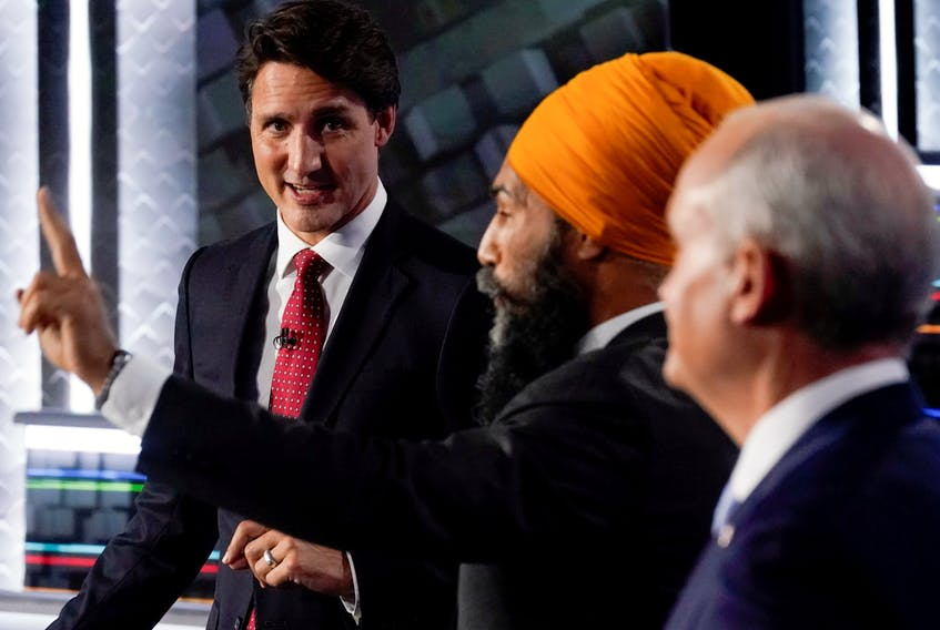 Liberal Leader Justin Trudeau, left to right, NDP Leader Jagmeet Singh, and Conservative Leader Erin O'Toole take part in the federal election English-language Leaders debate in Gatineau September 9, 2021.  Adrian Wyld/Pool via REUTERS