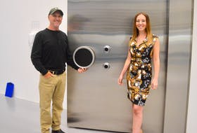 Doug Walsh and daughter Tiffany stand outside the heavy door to the high-security vault where Bluenose Labs Ltd. stores its cannabis products. The former is the facility manager, while the latter is the founder and president of Bluenose's parent company, Highlander Cannabis Corp. DAVID JALA/CAPE BRETON POST