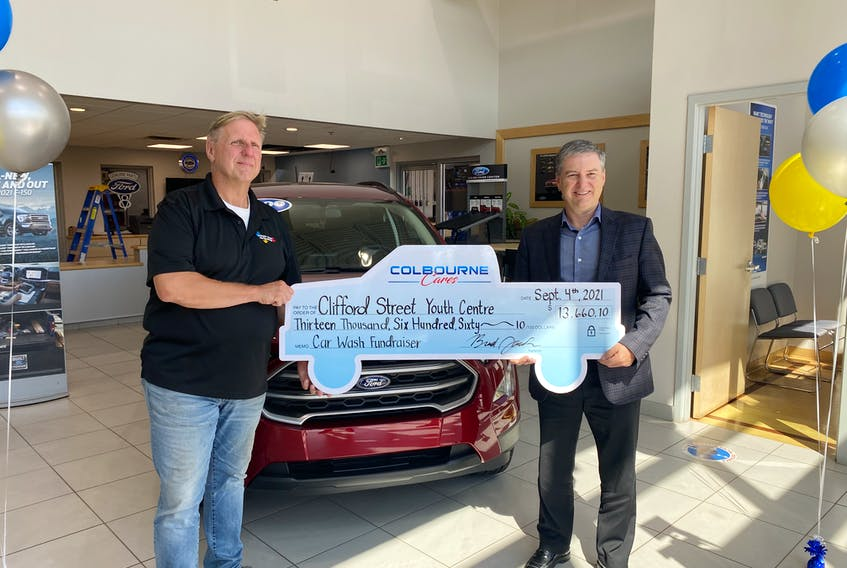 From left, Paul Ratchford, from the Clifford Street Youth Centre and Brad Jacobs, general manager of Colbourne Auto Group, revealed the grand total raised at the Sept. 4  car wash fundraiser for the centre. More than $13,600 was raised, which included a $5,000 donation from Joe Anthony of A&L Seafoods which was matched by Rodney Colbourne, owner and president of Colbourne Auto Group. CONTRIBUTED/COLBOURNE AUTO GROUP