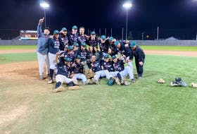 The Charlottetown Gaudet's Auto Body Islanders celebrate on the field at Kiwanis Park in Moncton, N.B., after winning the New Brunswick Senior Baseball League championship. The Islanders defeated the Moncton Fisher Cats 9-4 on Sept. 19 to win the best-of-seven final series in five games.