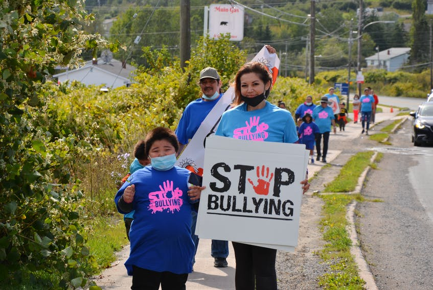 Juelz Gould, right, pictured with her son, Malsun, joined dozens of people for an anti-bullying march to support her 10-year-old daughter, Scarlet, who has been the victim of bullying for over a year by a group of older girls in the community. ARDELLE REYNOLDS/CAPE BRETON POST