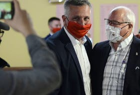 Malpeque Liberal candidate Heath MacDonald, left, is congratulated by Wayne Easter at the North River Fire Hall on Sept. 20. With only a few polls left to come, MacDonald, running federally for the first time, had unofficially won the riding with just over 40 per cent of the vote. Easter, who had represented the Malpeque riding for the Liberals since 1993, had announced his retirement as an MP earlier this year.