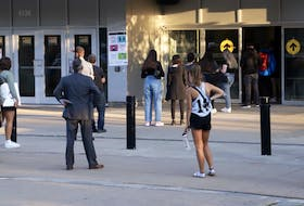 Young voters line up to cast their ballots for the federal election outside a polling station at Dalhousie University in Halifax early Monday evening, Sept. 20, 2021.