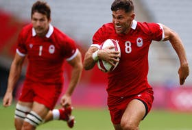 Justin Douglas of Canada runs through to score a try against the United States at the Tokyo Olympics on July 28, 2021.