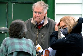 Jack Harris speaks to a voter while out canvassing for people to get out and vote in Monday's federal election. At right helping in the effort is Lana Payne.  Keith Gosse/The Telegram