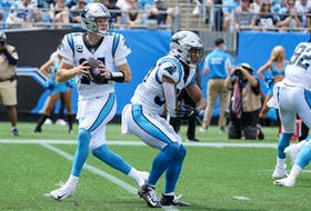 Carolina Panthers quarterback Sam Darnold  back to pass with Canadian running back Chuba Hubbard blocking against the New Orleans Saints.