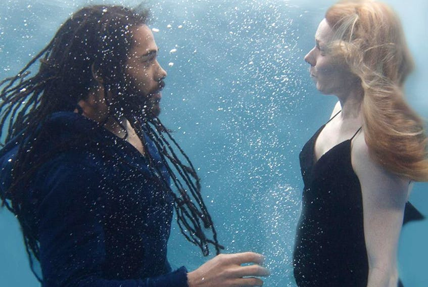 Luke Robinson and Fiona Graham, under the waves in Between Waves.