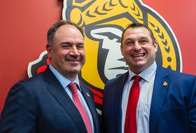 The Ottawa Senators' Pierre Dorion and  D.J. Smith shown at a press conference, May 23, 2019.