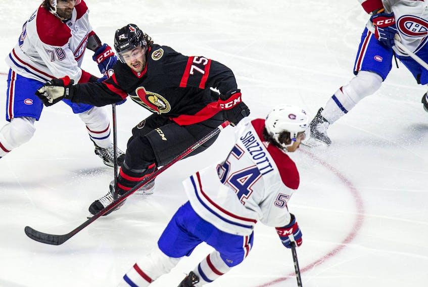 Ottawa Senators' Egor Sokolov battles Canadiens' Tory Dello (left) and Brendan Sirizzotti.