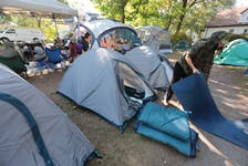 Rachelle Sauve, site coordinator for the 'People's Park' at the corner of Chebucto and Dublin starts tearing down three tents after alternative housing options have been found for the the three women who stayed there.