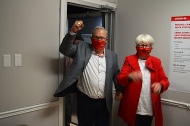 Cardigan MP Lawrence MacAulay, left, and his wife, Frances, arrive at his campaign headquarters in Stratford on Sept. 20 after winning his 11th consecutive term.