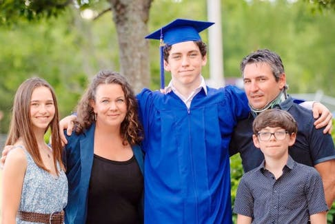 A neck brace helped Dan Ross, right, to stand upright and spend time with his family.