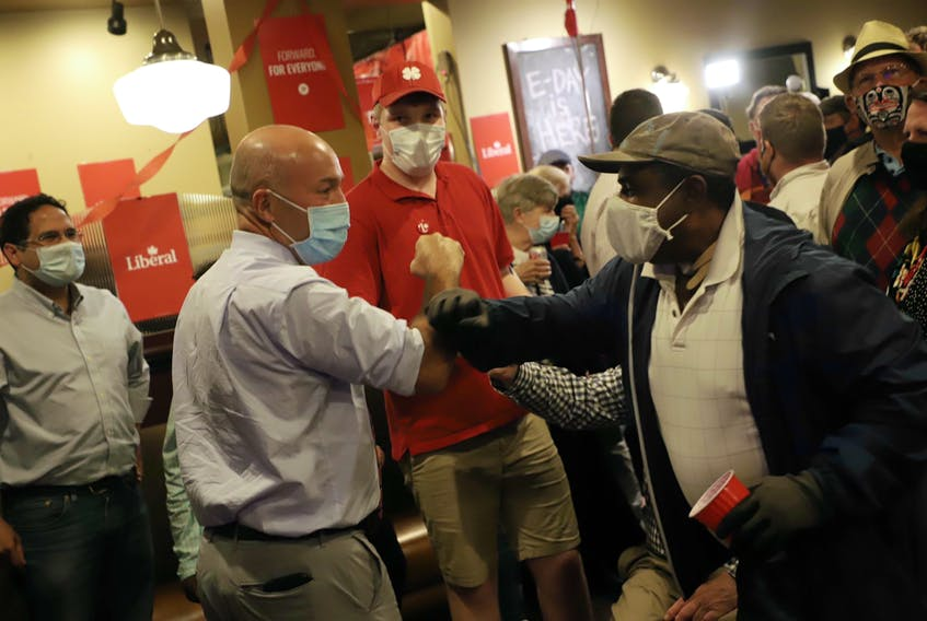 Andy Filmore is welcomed by supporters at his headquarters on Quinpool Road in Halifax just after midnight on Tuesday, Sept. 21, 2021. The Liberal incumbent said the race is still too close to call, as 1,245 votes separate him and NDP candidate Lisa Roberts, with 15 polls left to be counted.