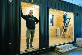 Greg Mullane, owner of Saltbox Modern Engineered Spaces, poses for a photo inside a container home that his company is building at his workshop in Middle Sackville on Tuesday. Ryan Taplin - The Chronicle Herald