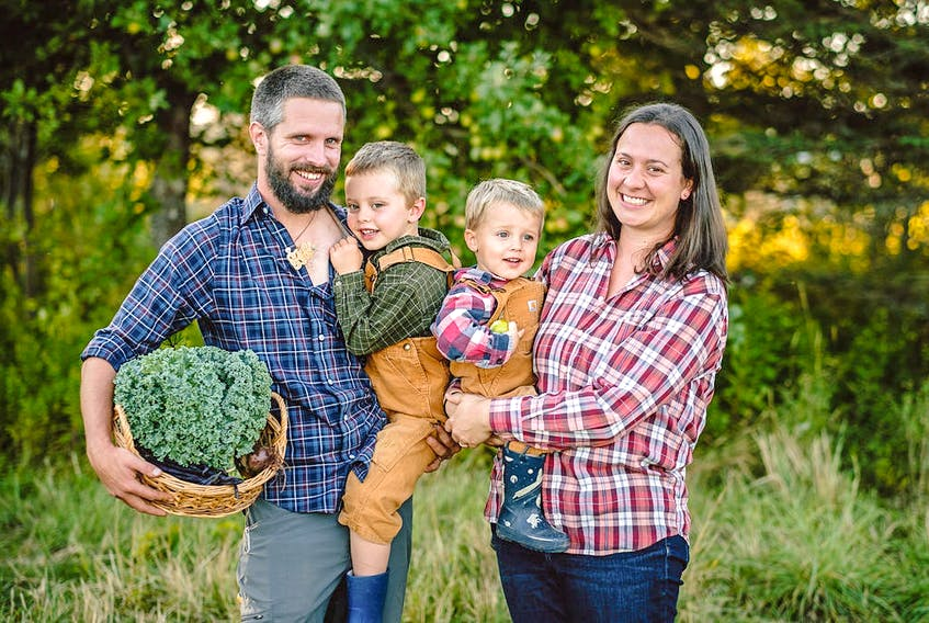 Andy Pedley, left, Kailea Pedley, fair right, and their sons Hugo, left, and Arthur, right, on their farm in Southwest Margaree. CONTRIBUTED/Photo by Steve Rankin