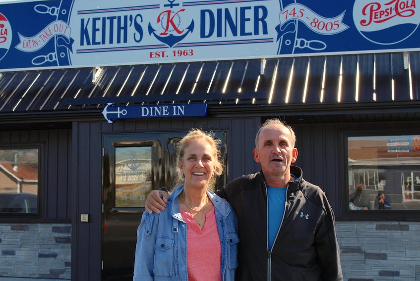 Jonelle Feaver grew up in the Goulds and is a huge fan of Keith's Diner, a family owned restaurant which has been open in the area since 1963. She's such a fan, her mother used to bring an order when she would fly to visit her in Toronto, where she now lives. Although she's already had it three times since landing in the province for a visit last Thursday, she plans on having it the day before she leaves as well. Next to her is Keith Ward, who was the owner/operator since 1989. Now that he's retiring, his daughter, Mallory, is the owner/operator.