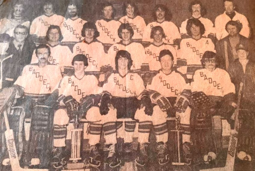 The Baddeck Gillis' Cats captured the Cape Breton Intermediate 'D' Hockey League championship, before losing in the provincial playdowns. The year for the title was not available. Front row, from left, Peter Woodford (stick boy), Roddie MacDonald, Patti Woodford, Jamie Campbell, Fraser MacLeod, Murdock MacLean, and Michael Harvey (stick boy). Middle row, from left, Murdock Matheson (manager), Sandy Gregg, Duncan MacKenzie, Shaun Dunlop, Fred MacLeod, Donald MacKenzie, and Duncan Gillis (sponsor). Back row, from left, Dr. Eollie Genge (team physician), Ernie MacIntosh, Tim Burkhart, Dave MacRae, Frankie MacDonald, Malcie MacIntyre, David Fraser, and Mickey Woodford (coach). PHOTO CONTRIBUTED.