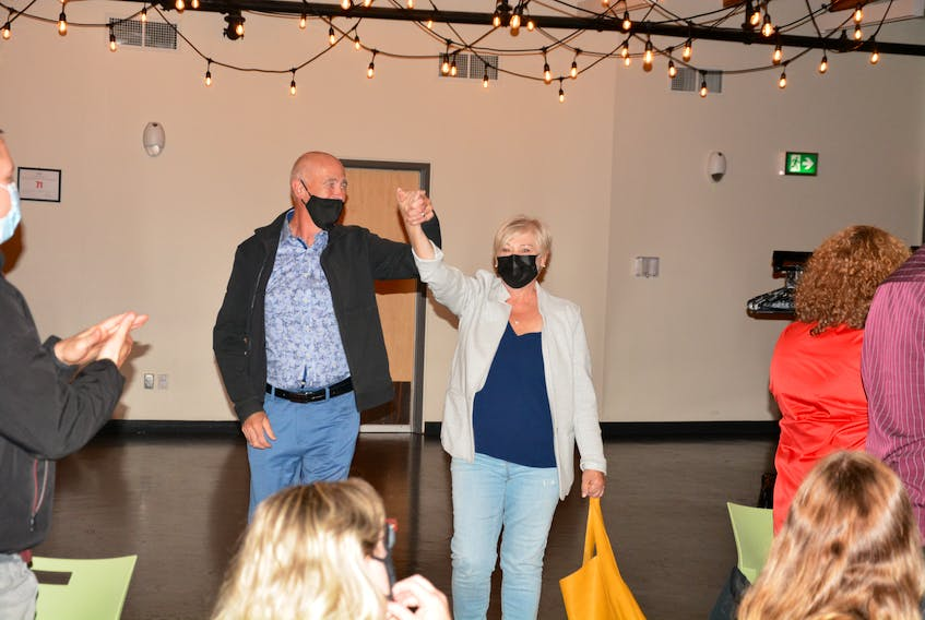 Liberal candidate Ken McDonald (left) for the district of Avalon raises his arms in victory alongside his wife Trudy moments after he was declared victorious in the 2021 federal election.