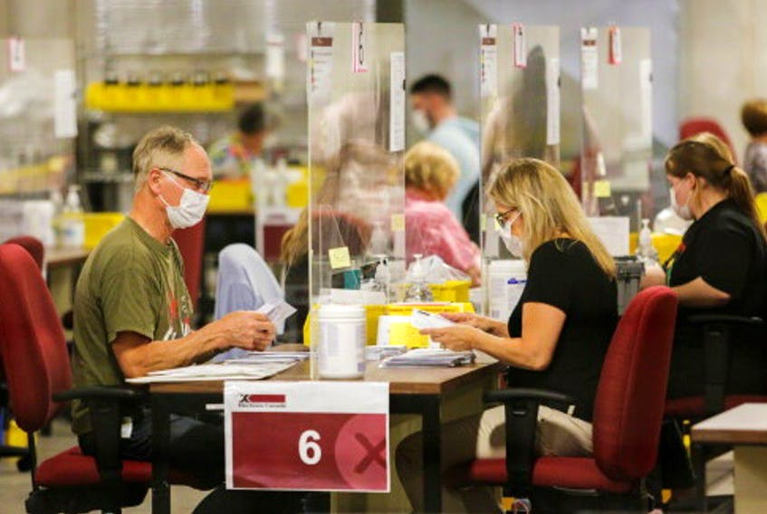 Special ballot officers count ballots from national, international, Canadian Forces and incarcerated electors that were received by mail during the federal election in Ottawa, Ontario, Canada, September 20, 2021.