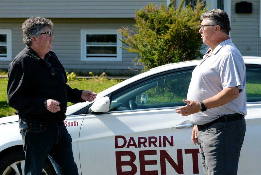 Conception Bay South mayoral candidate Darrin Bent (right) speaks with Duke Tobin while out campaigning in the town Tuesday.  Keith Gosse/The Telegram