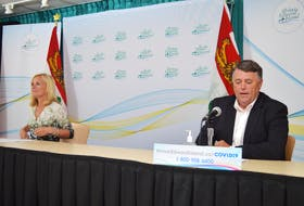 Dr. Heather Morrison, left, P.E.I.'s chief public health officer, and P.E.I. Premier Dennis King take part in a COVID-19 briefing on Tuesday, Sept. 21.