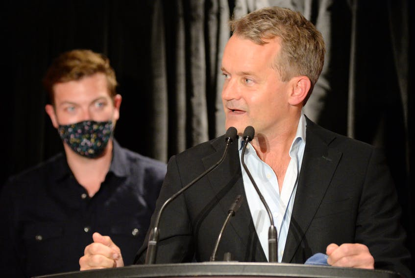 Newfoundland and Labrador still mostly red   Re-elected St. John's South-Mount Pearl MP Seamus O'Regan speaks supporters after he was declared the winner in the riding Monday. At left is his husband Steve Doussis. Newfoundland and Labrador remained mostly Liberal red as the votes came in Monday night. For more details see full story page A3 and visit SaltWire.com for complete elections results and analysis Keith Gosse/The Telegram