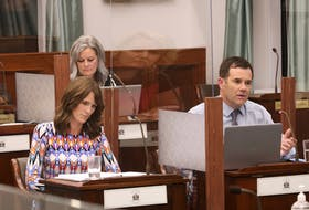Minister of Education Natalie Jameson listens as Public Schools Branch director responds to questions during a standing committee meeting. The two faced questions about the province's back-to-school plans and the weeks leading up to the West Royalty outbreak of COVID-19