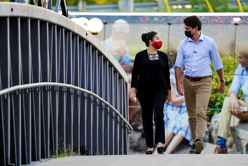 Justin Trudeau walks with Liberal candidate Maryam Monsef during a campaign stop in Peterborough, Ont., on Sept. 18, 2021. Monsef is projected to lose the riding to Conservative candidate Michelle Ferreri.