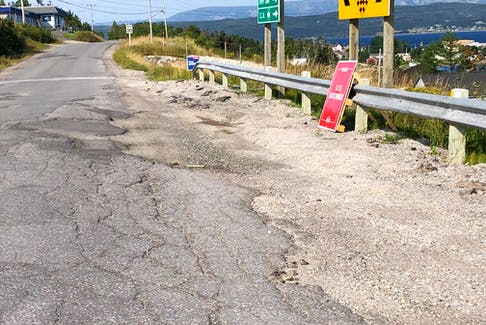 This section of road in Woody Point at the intersection to the road with Trout River needs some repairs.