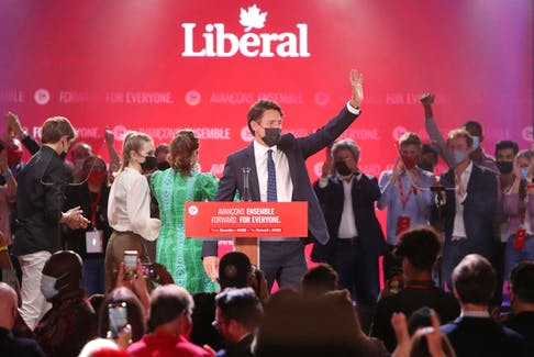 Justin Trudeau, Canada's prime minister, waves to supporters during a Liberal Party election night event in Montreal, Quebec, Canada, in the early hours of Tuesday, Sept. 21, 2021.