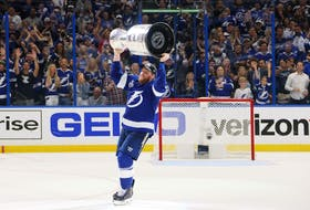 Blake Coleman #20 of the Tampa Bay Lightning celebrates with the Stanley Cup after the 1-0 victory against the Montreal Canadiens in Game Five to win the 2021 NHL Stanley Cup Final at Amalie Arena on July 07, 2021 in Tampa, Florida.