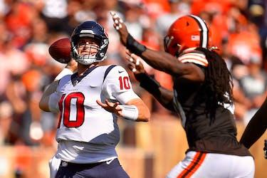 Quarterback Davis Mills of the Houston Texans throws the ball.