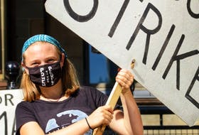 Lilian Hougan-Veenma, a Grade 12 student at Citadel High School in Halifax, holds a sign during the Climate Strike Halifax-led climate rally in September 2020. The group will hold another rally in downtown Halifax on Friday, starting at noon at Victoria Park.