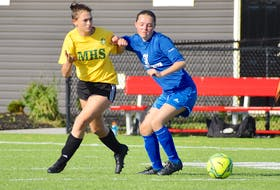 Angelina Cameron of the Sydney Academy Wildcats, right, battles for body position with Sara Barnes of the Memorial Marauders during Cape Breton High School Soccer League girls' junior varsity action at Open Hearth Park in Sydney, Tuesday. Memorial won the game 3-1. JEREMY FRASER/CAPE BRETON POST.