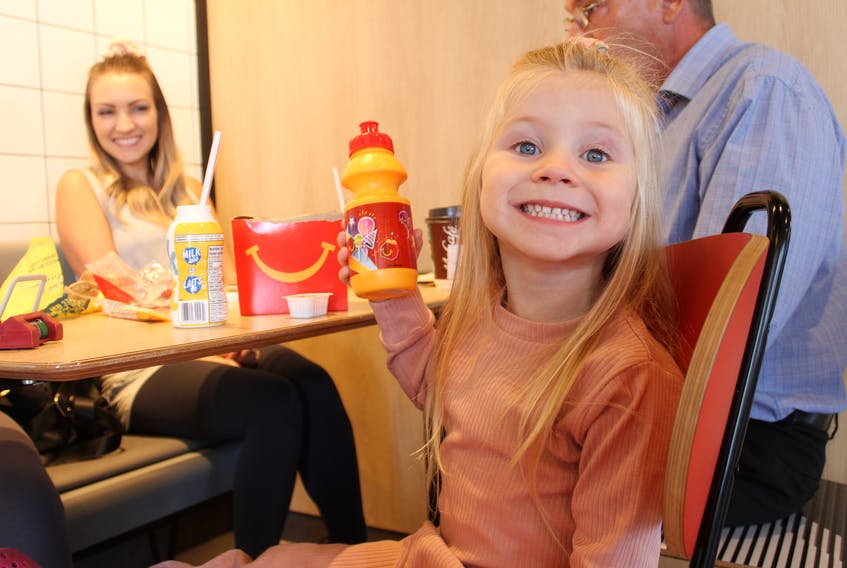 Three-year-old Zoey Murray holds up the water bottle she got on McHappy Day on Sept. 22, the annual fundraiser done at McDonald's Restaurants in Canada for Ronald McDonald House. Along with the sale of items like burger socks, tote bags and water bottles, a portion of all proceeds from all sales at McDonald's is donated to Ronald McDonald House Charities which helps seriously sick children and their families. The fundraising goal for McHappy Day 2021 in the Cape Breton Regional Municipality is $50,000. The last McHappy Day was in 2019 and $87,000 was raised locally. NICOLE SULLIVAN/CAPE BRETON POST
