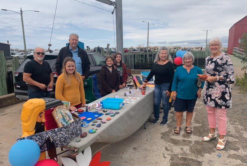 The first Kidtrepreneur Business Fair took place recently in Halls Harbour. From left are Kings County Coun. Dick Killam; Kings North MLA John Lohr, participants Mackenna Killam, Kaylee Johnson and Sophia Sherman, organizer Madonna Spinazola, advocate for women in business Gordia Macdonald and Heather Lohr. CONTRIBUTED