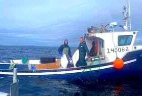 Marc Russell and Joey Jenkins have been missing off the coast of Mary's Harbour since Sept. 17. This photo from Marc's father Dwight Russell's Facebook account shows Marc and Joey Jenkins on on the fishing vessel, Island Lady. Facebook/dwight.russell.121