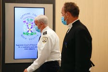 """FOR NICOLE MUNRO STORY: Andrew Miller, security risk manager at the Central Nova Scotia Correctional Facility, left and Crown Prosecutor Rick Woodburn are seen during a break in proceedings for the """"Burnside 15"""", being held at the Convention Centre in Halifax Wednesday September 22, 2021.  TIM KROCHAK PHOTO"""