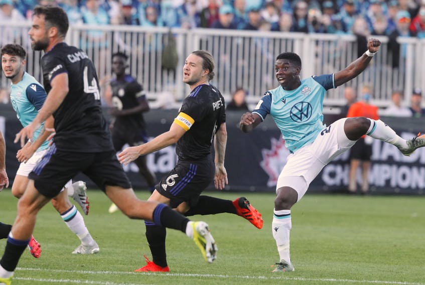 HFX Wanderers' Corey Bent, right,  watches his shot go into the  CF Montreal net as a couple of defenders look on helplessly during the Canadian Championship soccer quarter-final game at the Wanderers Grounds on Wednesday night. Eric Wynne