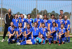 The Whitney Pier under-13 girls' soccer team captured the Cape Breton Cup championship last month at MacKinnon Memorial Field in New Waterford. The team defeated the Northside Storm 2-1 in the final game. Front row, Mikayla Dryer. Middle row, from left, Karley Lawless, Davis Sullivan, Ava Carew, Abi Morrison, Kathleen Brann, Evenny Harker-Alvarado, and Maddox Ross. Back row, from left, Jonathan MacIsaac (coach), Cailin MacKinnon, Mya McGee, Akasha Hartling, Kal Campbell, Hannah Latham, Ryelyn Gabriel, Madelyn MacGillivary, Maisie MacPhee, and Neil Harker (coach). PHOTO CONTRIBUTED/SUSIE MACARTHUR.