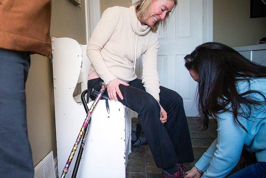 Jessica Service and Karin Hohban have developed a close friendship after the Westboro bus crash. Service helped to save Hohban's leg the day of the crash and was helping her with her shoe on Sunday Jan. 5, 2020.