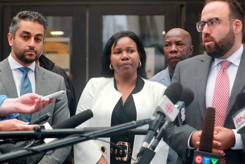 Aissatou Diallo – the driver in the Westboro bus crash – was found not guilty on all counts Wednesday. She emerged from the courthouse with her two lawyers, Solomon Friedman, right, and Fady Mansour, left.