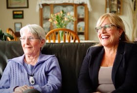 Kay Eyland (left) is pictured beside her daughter, Dawn (right) wearing her Northwood Intouch help button, which she says has been a god send. - Photo Contributed.