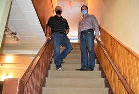 Truro Curling Club board members Cletus MacIsaac and Randy Degrass stand in the stairwell of the club, which currently can't  accommodate all visitors to the facility. A new accessibility lift is in the works with a fundraiser campaign to add to money already donated or secured through grants for the work.