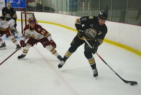Charlottetown Islanders defenceman Will Trudeau makes a play while under pressure from the Acadie-Bathurst Titan's David Doucet during a Quebec Major Junior Hockey League pre-season game at MacLauchlan Arena in Charlottetown on Sept. 10. The Islanders close out the pre-season schedule with a home-and-home series against the Moncton Wildcats this weekend. The teams meet at MacLauchlan Arena I Charlottetown on Friday at 7 p.m., and in Bouctouche, N.B., on Sept. 26 at 4 p.m.